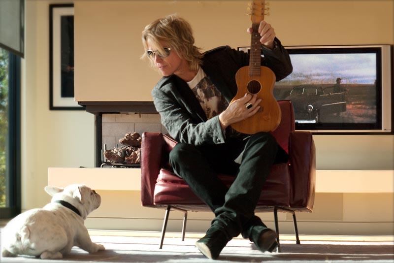Brian Ray with ukulele and dog