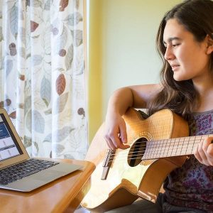 Woman playing guitar with TuneLing